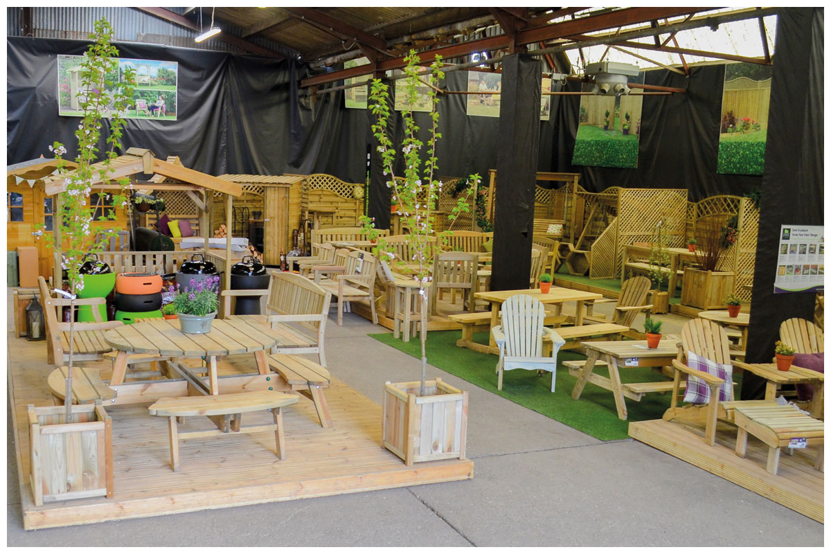 Large range of Zest 4 Leisure timber garden furniture on display at the garden centre.